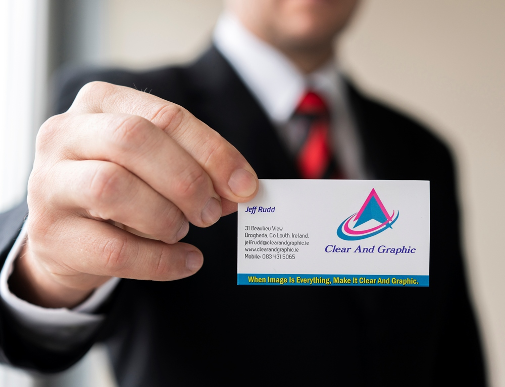 Businessman holding business card mock-up with one hand 2sm